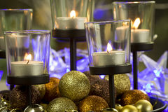 Christmas background with candles and baubles Stock Image