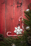Christmas  background with candy  pine branches and pine cone, decorations on red wooden rustic background top view Royalty Free Stock Image