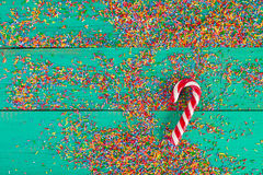 Christmas background. Christmas canes Color sprinkling on turquoise wooden background. stock photography