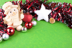 Christmas background or card. Cute snowman, christmas balls and white snowstar with empty space for text Stock Images