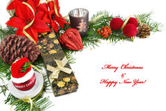 Christmas background, card with baubles, poinsettia, gift, fir and decorations on white. Royalty Free Stock Photography