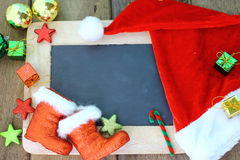 Christmas background with chalkboard and decoration. S stock photography