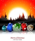Christmas background with christmas ball and forest Stock Photo