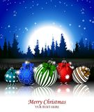 Christmas background with christmas ball and night forest Royalty Free Stock Photos