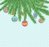 Christmas background with Christmas Balls Hanging on a Christmas tree branch Stock Images