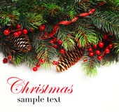 Christmas background. Christmas boarder with fir tree branch with cones and ornament. Christmas baubles in golden and red colour. Close up with copy space and Stock Image