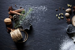Christmas background. Christmas cookies and spices on black stone background Stock Photo