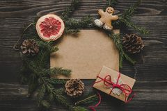 Christmas background. Christmas decoration with fir branches and christmas gift on the wooden table Royalty Free Stock Photography