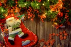 Christmas background. Christmas fir tree, Christmas socks on gray wooden board background. Top view, copy space stock image