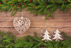Christmas background. Christmas fir tree, Christmas tree toy, gifts on old wooden background with copy space. Toned Royalty Free Stock Photos