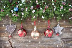 Christmas background. Christmas fir tree with decoration on wooden board background. Stock Photography