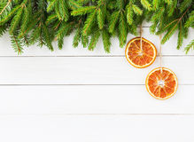 Christmas background. Christmas fir tree with orange decoration on white wooden board background, copy space Stock Images