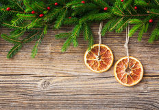 Christmas background. Christmas fir tree and orange on old wooden background, copy space Stock Photography
