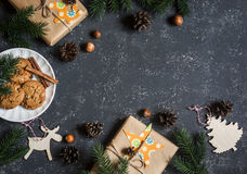 Christmas background. Christmas gifts, decorations, cookies, christmas tree. On a dark background, top view. Free space for text. Royalty Free Stock Images