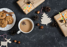 Christmas background - christmas homemade gifts, decorations, tea and biscuits. On a dark background, top view. royalty free stock photography