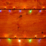 Christmas background with christmas lights on the table Royalty Free Stock Photography