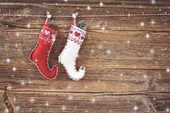 Christmas background. Christmas socks on old wooden background. Top view Royalty Free Stock Images