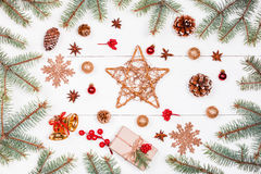 Christmas background with Christmas star, gift, fir branches, pine cones, snowflakes, red decorations. Xmas and Happy New Year Royalty Free Stock Photos