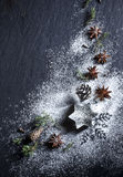 Christmas background. Christmas stars and spices on black stone background Royalty Free Stock Photo