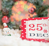 Christmas background.Christmas stocking embroidered with the date 25th of December. Christmas background, blurry lights. Stock Photo