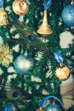 Christmas Background with Christmas Tree,  Balls and feathers Royalty Free Stock Photography