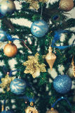 Christmas Background with Christmas Tree,  Balls and feathers Stock Images