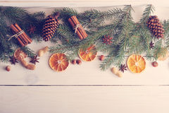 Christmas background with Christmas tree branches, pine cones, d Royalty Free Stock Photos