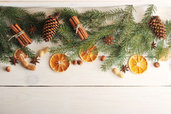Christmas background with Christmas tree branches, pine cones, d Stock Photos