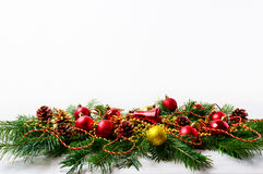 Christmas background with Christmas tree branches and red orname Royalty Free Stock Image