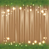 Christmas background with christmas tree feers, star-shaped golden confetti on wooden background. Vector illustration, eps10. Stock Image