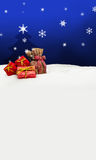 Christmas background - Christmas tree - gifts - blue - Snow Stock Photography
