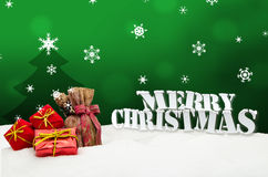 Christmas background - Christmas tree - gifts - green - Snow Stock Photo