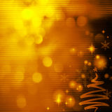 Christmas background with Christmas tree. Gold Festive Christmas background with Christmas tree. Elegant abstract background with bokeh defocused lights and Royalty Free Stock Image