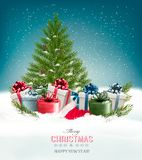 Christmas background with a christmas tree and presents. Stock Image