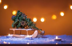 Christmas background with Christmas tree, sled, snow, candles, bokeh lights. Beautiful Christmas background with Christmas tree, sled, snow, candles, bokeh Stock Images