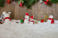 Christmas background with Christmas tree and snowman on a rustic Royalty Free Stock Photography