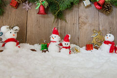 Christmas background with Christmas tree and snowman on a rustic Stock Images