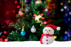 Christmas background with Christmas tree and snowman on snow. Close up Christmas tree decorated with snowman and christmas ball Stock Images