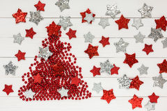 Christmas background. Christmas tree, White wooden background, stars, copy space Stock Photos