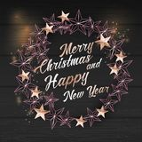 Christmas Background with Christmas Wreath of Cutout Shining Gold Stars Royalty Free Stock Image