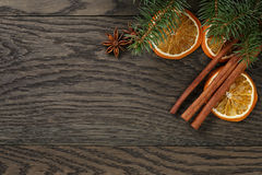 Christmas background with cinnamon anise and oranges Royalty Free Stock Image