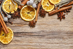 Christmas background: cinnamon sticks, dried oranges and anise s Stock Image