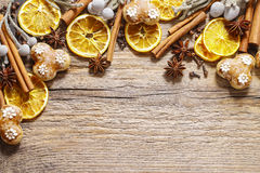Christmas background: cinnamon sticks, dried oranges and gingerb Royalty Free Stock Photography