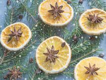 Christmas background with citrus fruit of orange slices and star anise on the spruce branches. Royalty Free Stock Photos