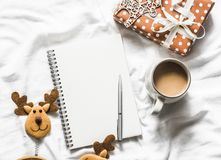 Christmas background. Clean blank notepad, coffee, gift box, christmas decorations on light background, top view. Flat lay stock image