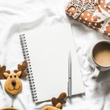 Christmas background. Clean blank notepad, coffee, gift box, christmas decorations on light background, top view. Flat lay royalty free stock photos