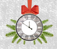 Christmas background clock with pine tree and red bow Happy New Royalty Free Stock Photos