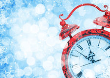 Christmas background with clock and snow bokeh Royalty Free Stock Photos
