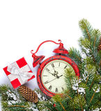 Christmas background with clock and snow fir tree Royalty Free Stock Images