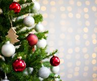 Christmas background - close up of decorated christmas tree over Stock Images